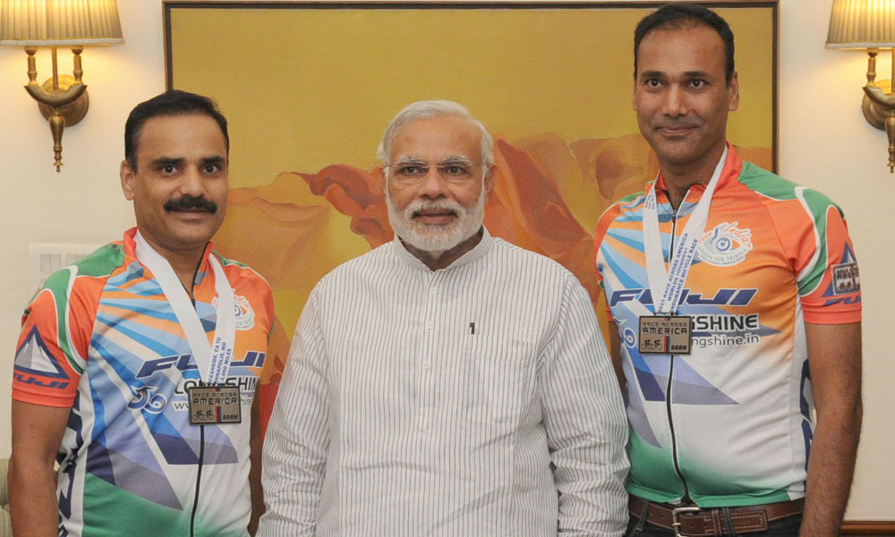 Delhi,20 Oct 2015: The Cycling Award Winners, Dr. Hitendra Mahajan and Dr. Mahendra Mahajan from Nashik, calling on the Prime Minister, Narendra Modi