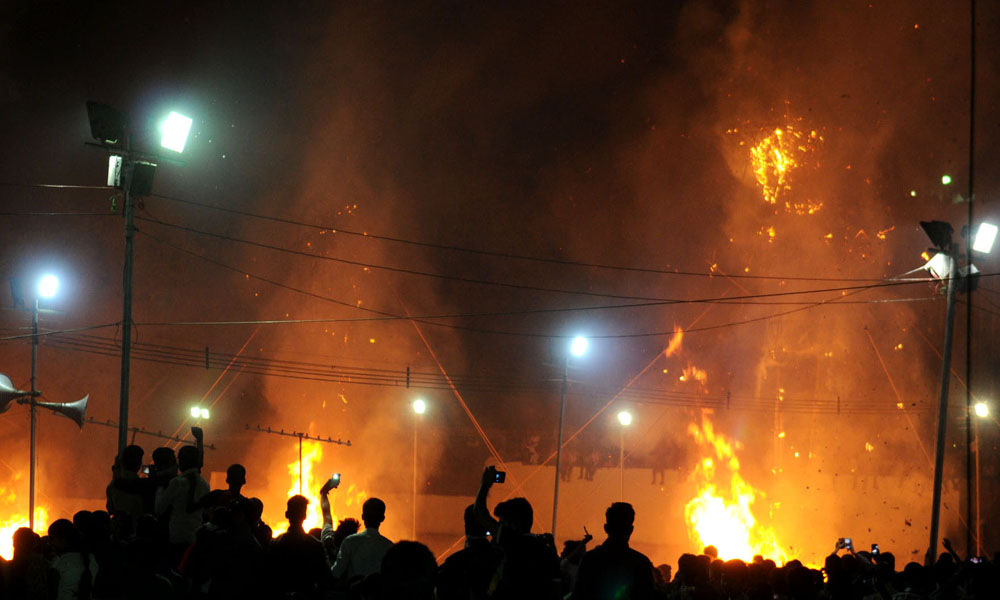 Delhi, 23 Oct 2015: The Ravana effigy in flames at the Dussehra celebrations, at Ramleela Maidan on the auspicious occasion of Vijay Dashmi.