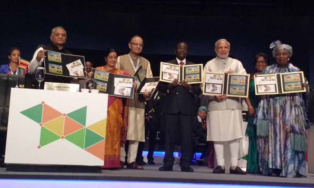 Delhi, 30Oct 2015: PM Narendra Modi, President Mugabe, AU Chairperson and Cabinet Colleagues release comm coins and stamps of IAFS