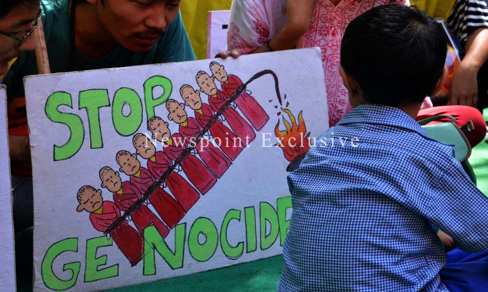 Delhi, 10 Sept, 2015: Exiled Tibetans hold condolence prayer for woman self-immolator