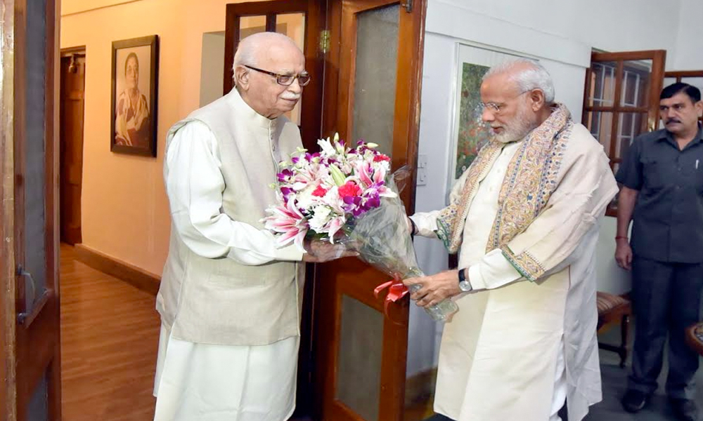 Delhi, 08 Nov. 16: PM Narendra modi meets senior BJP leader LK Advani at his residence to greet him on his 89th birthday.
