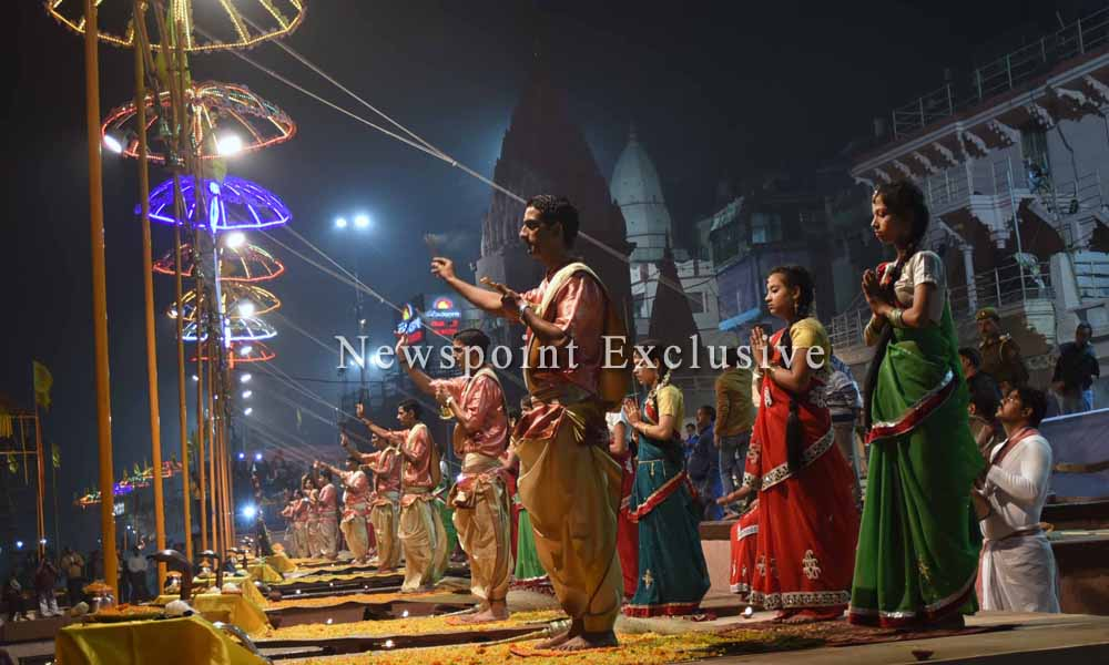 Banaras,3rd January 2014: Devotees performing Ganga aarti together at the beautifully decorated Ghat