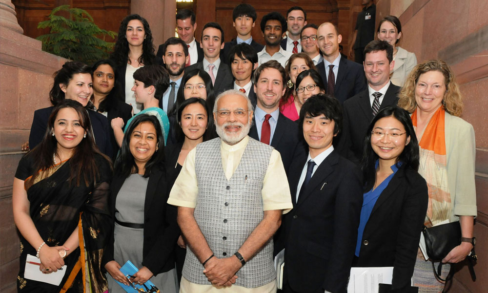 New Delhi, 23rd March 2016: The Prime Minister, Narendra Modi in a group photograph with the group of students of International Policy Studies from Stanford University.