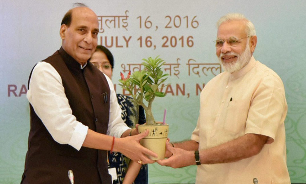 Delhi, 17 July 2016: Home Minister Rajnath Singh presents Bonsai plant to PM Narendra Modi at 11th Inter-State Council Meeting.
