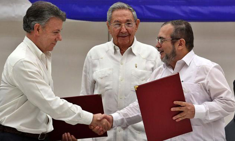 Colombian, 27 sep 2016 : Colombian President Juan Manuel Santos and Marxist rebel leader Timochenko used a pen made from a bullet to sign an agreement ending a half-century war that killed a quarter of a million people and made their nation a byword for violence.