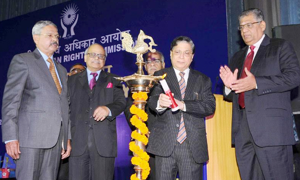 Delhi, 13th Oct.2017: The Chief Justice of India, Justice Shri Dipak Misra lighting the lamp during the 24th Foundation Day Function of the National Human Rights Commission (NHRC)
