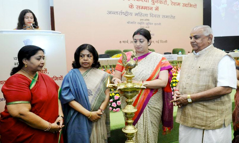 Delhi, 8th March.2017: The Union Minister for Textiles, Smt. Smriti Irani lighting the lamp on the occasion of the International Women's Day 2017
