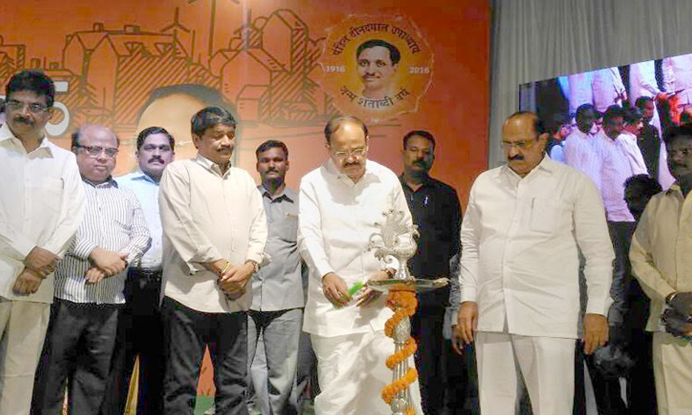 "Visakhapatnam, 12th June.2017: Union Minister, Shri M. Venkaiah Naidu lighting the lamp to inaugurate the ""Sabka Saath Sabka Vikas"" Sammelan, in Andhra Pradesh"