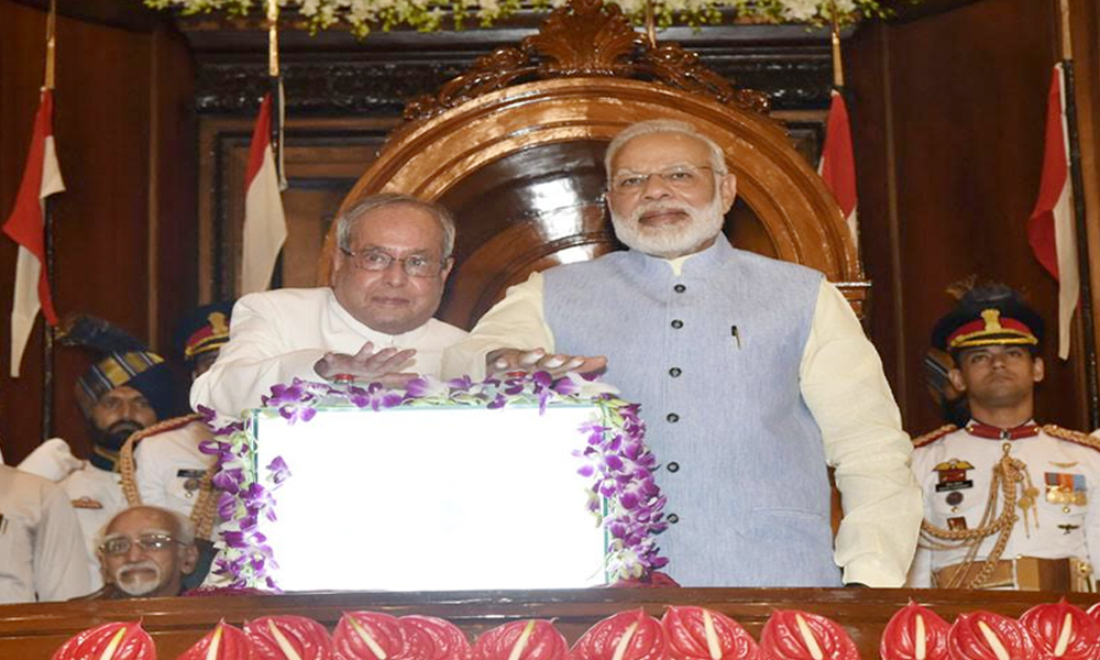 Delhi, 1st July 2017: Shri Pranab Mukherjee and Shri Narendra Modi pressing the buzzer to launch the Goods & Service Tax (GST), in Central Hall of Parliament in the midnight of June 30- July 01