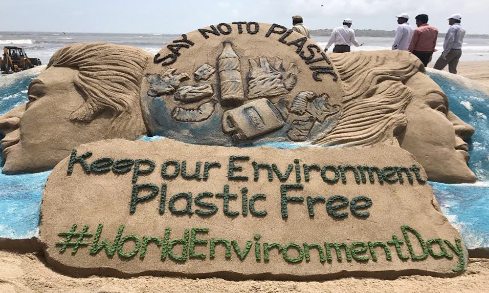 Delhi, 5th June.2017: Sand artist Sudarsan Pattnaik creates Sand Sculpture with message ``Keep Our Environment Plastic Free`` for World Environment Day at Versova Beach