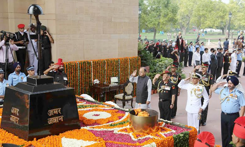 Delhi, 26th July.2017: Shri Arun Jaitley along with the Chief of Army Staff, General Bipin Rawat, the Chief of the Air Staff, Air Chief Marshal B.S. Dhanoa and the Vice Chief of the Naval Staff, Vice Admiral Karambir Singh paying homage to the martyrs at Amar Jawan Jyoti, India Gate, on the occasion