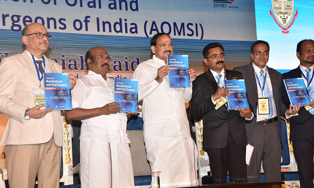 The Vice President, M. Venkaiah Naidu releasing the souvenir at the 43rd National Conference of Oral & Maxillofacial Surgeons of India, in Chennai.