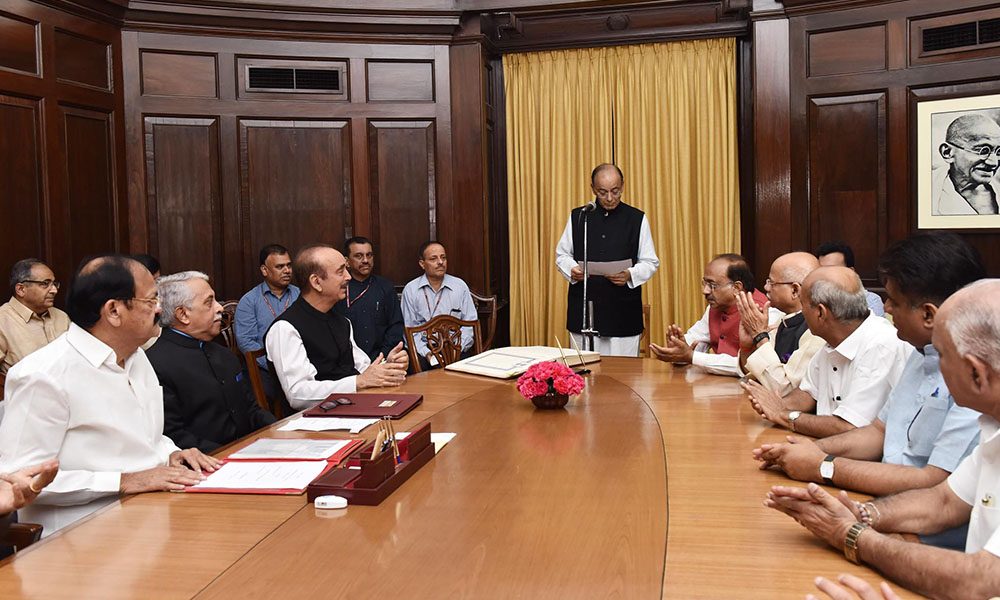 Vice President and Chairman, Rajya Sabha, M. Venkaiah Naidu administering the oath as Member, Rajya Sabha to Shri Arun Jaitley, at a Swearing-in Ceremony, at Parliament House, in New Delhi