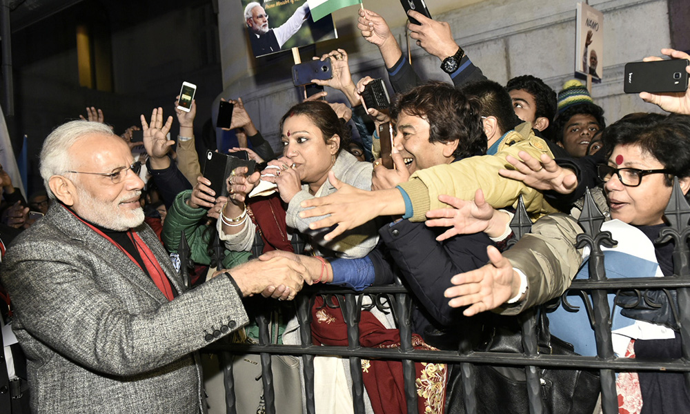 The Prime Minister, Narendra Modi being greeted by the Indian Community, at Stockholm, Sweden.