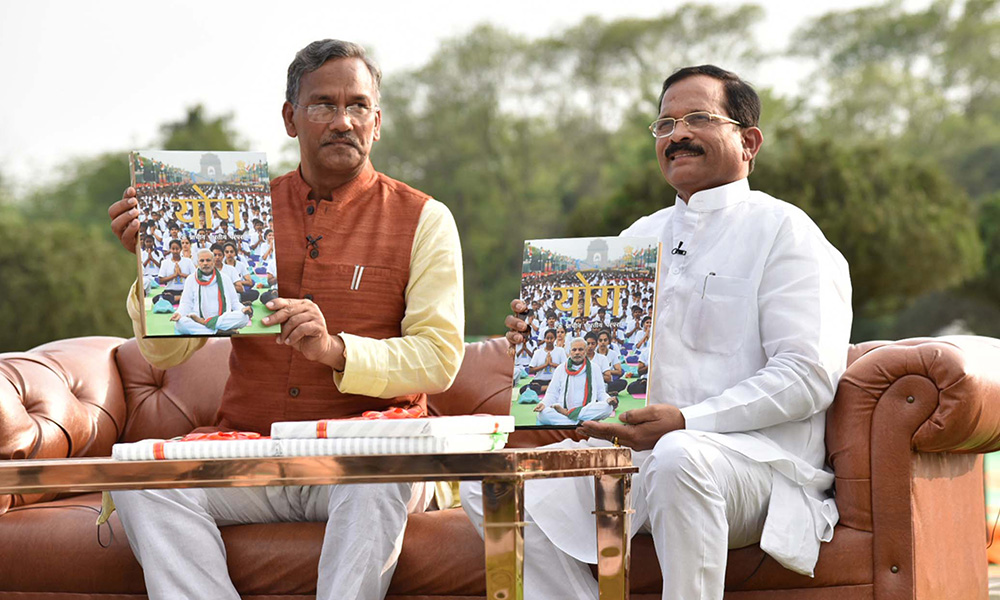 The MOS  for AYUSH (Independent Charge), Shripad Yesso Naik along with the CM of Uttarakhand, Trivendra Singh Rawat at a Yoga Day special show, on the eve of the 4th International Day of Yoga 2018.