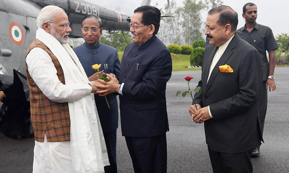 The Prime Minister, Narendra Modi being welcomed by the Governor of Sikkim, Ganga Prasad, the Chief Minister of Sikkim, Pawan Kumar Chamling and the Minister of State for Development of North Eastern Region (I/C), Prime Minister's Office, Personnel, Public Grievances & Pensions, Atomic Energy and Space, Dr. Jitendra Singh, on his arrival at Gangtok, Sikkim