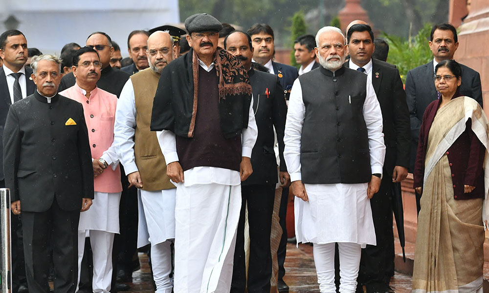 The Vice President, M. Venkaiah Naidu, the Prime Minister, Narendra Modi, the Union Home Minister, Amit Shah, the Union Minister for Parliamentary Affairs, Coal and Mines, Pralhad Joshi and other dignitaries at an event to pay homage to the martyrs of the 2001 Parliament attack, at Parliament building, in New Delhi