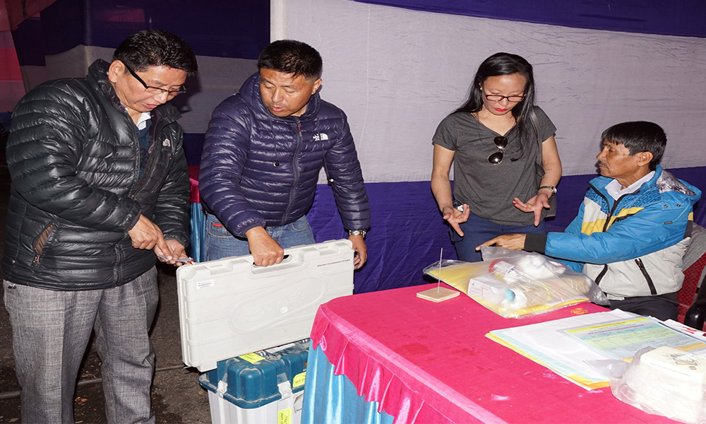 Polling officials collecting the Electronic Voting Machine (EVMs) and other necessary inputs required for the General Elections-2019, at the distribution centre, at Darjeeling, in West Bengal.