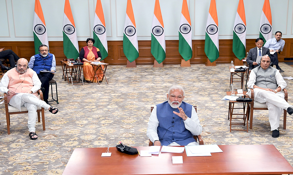 The Prime Minister, Narendra Modi interacting with the Chief Ministers of States via video conferencing to discuss measures to combat COVID-19, in New Delhi.
