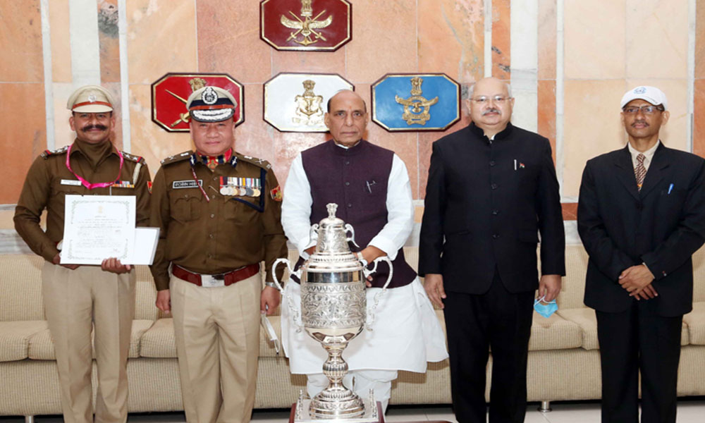 Union Minister for Defence, Rajnath Singh in a group photo with Special Commissioner of Police, Robin Hibu, the best marching contingent of Republic Day Parade 2021 among the Central Armed Police Forces (CAPF) and other auxiliary services, in New Delhi.