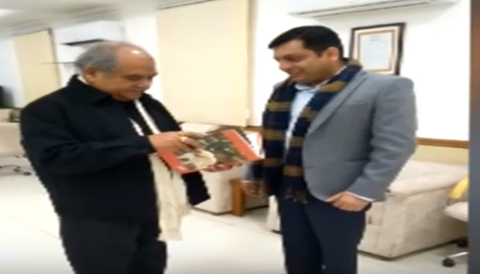"""Author Rahul Agarwal presents his book """" Turbulence & Triumph: The Modi Years"""" to  Union Minister."""